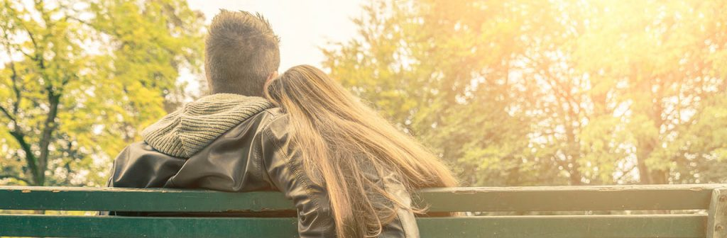 Couple together on bench